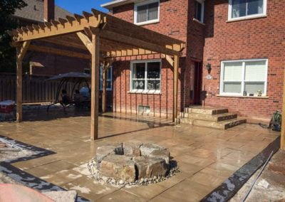 landscape Burlington stone deck with wooden pergola